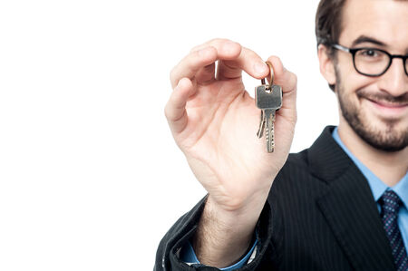 landlord: Cropped image of landlord offering the house keys Stock Photo