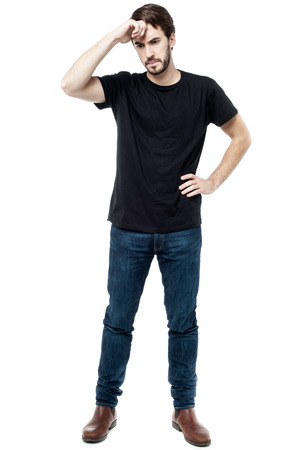 anxious: Young man worried about his mistake, hand on forehead. Stock Photo