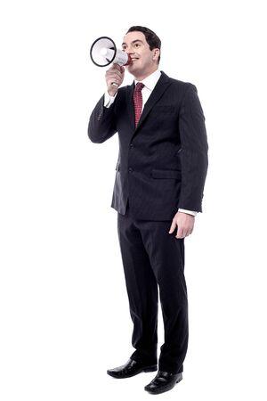 making an announcement: Full length of businessman making announcement