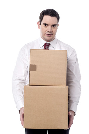 Corporate man with a cardboard boxes in hand photo