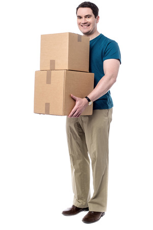 Smiling delivery man holding a big parcels photo
