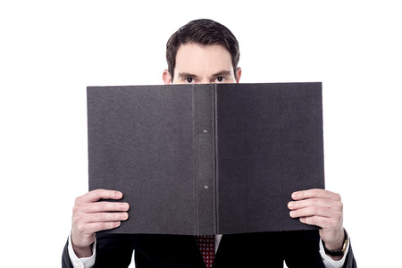 fascicule: Businessman has covered his face with folder