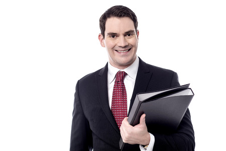 fascicule: Smiling male entrepreneur holding a black folder Stock Photo