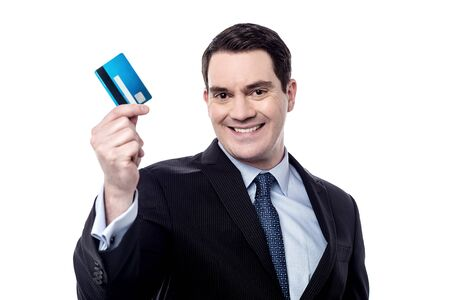 debit card: Smiling male executive showing his debit card