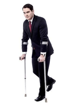 crutches: Businessman man trying to walk with crutches