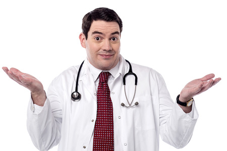 Experienced male doctor asking with open arms Stock Photo