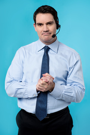 clasped hands: Customer support executive with clasped hands
