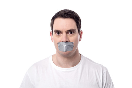 gagged: Casual man mouth covered by masking tape