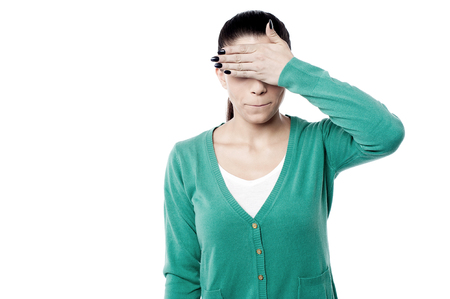 Young woman covering her eyes photo