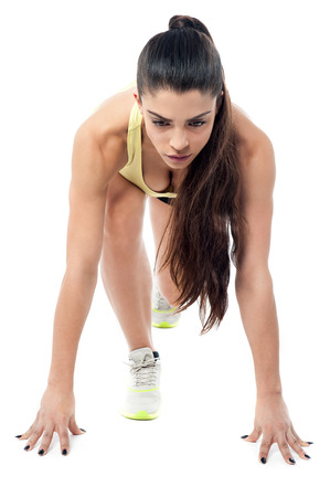 crouched: Athletic woman crouched down in starting position Stock Photo