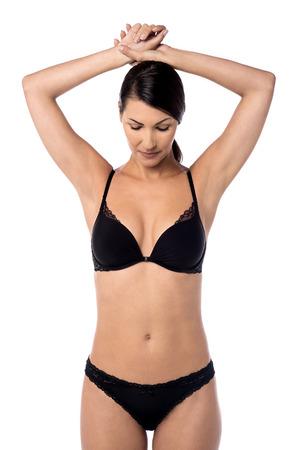pits: Beautiful woman in black underwear showing armpits