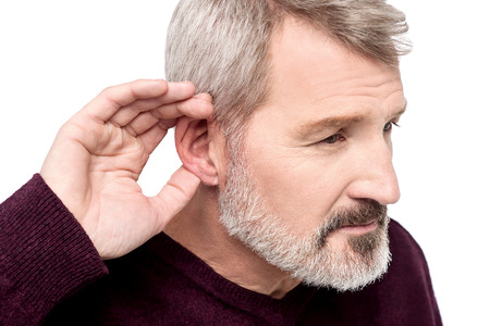 perceive: Mature man cupping his hand behind ear