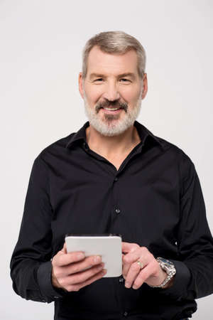 dial pad: Smiling aged man holding a new digital tablet