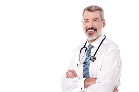 Experienced male doctor posing over white Banque d'images
