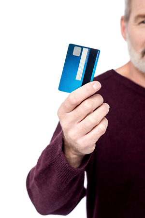 Cropped image of male hand showing debit card