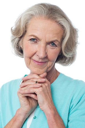 clasped hands: Close up of aged woman with clasped hands