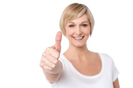 posing  agree: Happy woman making thumbs up gesture