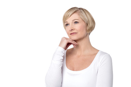 skepticism: Pensive woman touching her face over white Stock Photo