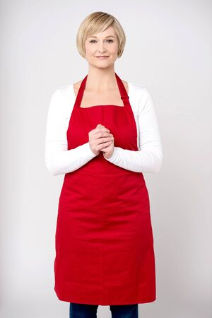 clasped: Beautiful woman chef posing with hands clasped