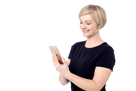 Smiling woman messaging from her mobile phone photo