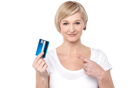 choosing selecting: Attractive woman showing and pointing her cash card