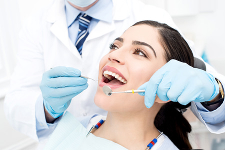 oral care: Young female patient receiving dental care