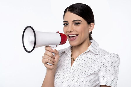 loudhailer: Happy young woman advertising with loudhailer Stock Photo