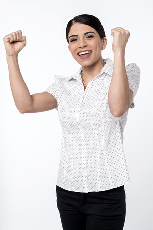 arms up: Happy woman celebrating with arms up joy of winning Stock Photo