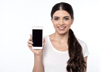 Female representative showing mobile with blank screen Stock Photo