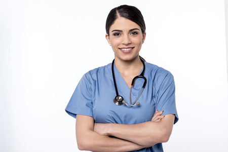 Confident female doctor with her arms folded Banque d'images
