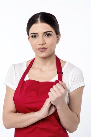 hands clasped: Young female chef with her hands clasped