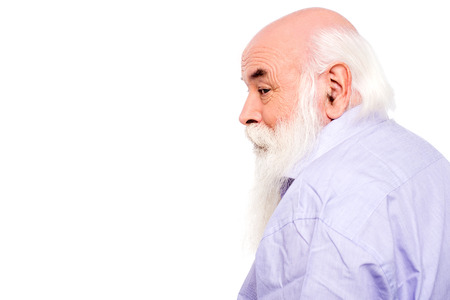 bald: Side view of senior man looking to camera