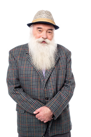 casually: An old man posing casually to camera over white Stock Photo