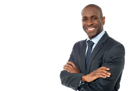 Cheerful businessman with folded hands
