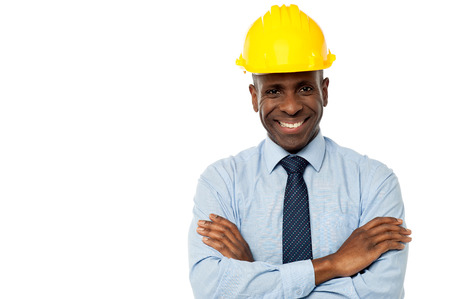 service engineer: Construction engineer in hard hat with his arms crossed Stock Photo