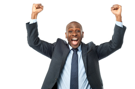 thrilled: Excited african entrepreneur clenching his fists Stock Photo