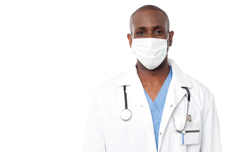 surgical mask: Portrait of physician with surgical mask