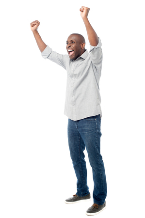 clenching fists: African middle aged man clenching fists Stock Photo