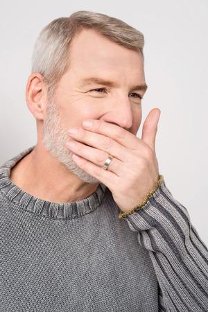 tedious: Senior man placing hand on mouth yawning Stock Photo