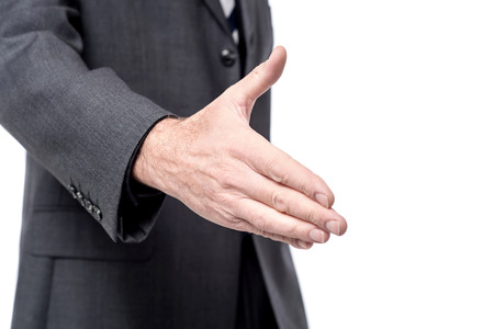 extending: Cropped image of business man extending hand to shake