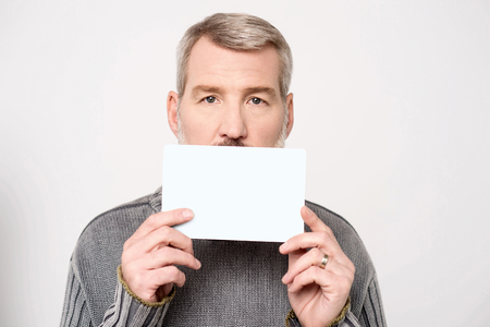 advertise with us: Casual mature man showing his business card