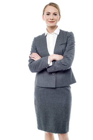 folded arms: Smiling business woman with folded arms Stock Photo