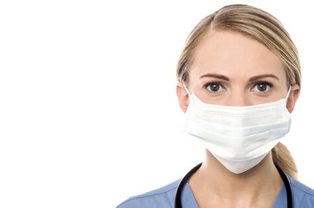 surgical mask: Smiling female doctor with surgical mask