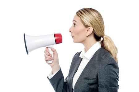 loudhailer: Female executive make advertising with loudhailer Stock Photo
