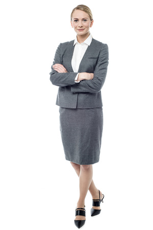 business woman legs: Full length of businesswoman with folded arms