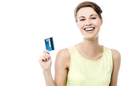 cash card: Cheerful woman showing her new credit card Stock Photo