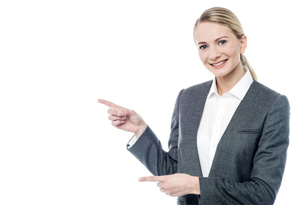 Female executive pointing something at copyspace Standard-Bild