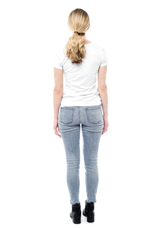 casuals: Girl in trendy casuals from behind