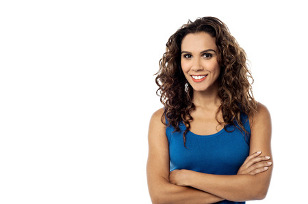 Smiling young woman posing with folded arms Stock Photo