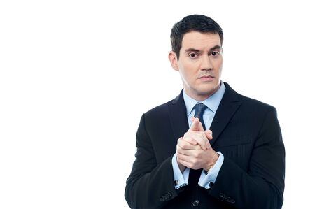 hands clasped: Confident businessman holding his hands clasped